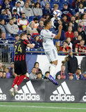 DeJuan Jones (24), Brek Shea (20) during Revolution and Atlanta United FC MLS match at Gillette Stadium in Foxboro, MA on Saturday, April 13, 2019. Atlanta United won 2-0. CREDIT/ CHRIS ADUAMA