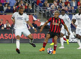 Andrew Farrell (2), Josef Martinez (7) during New England Revolution and Atlanta United FC MLS match at Gillette Stadium in Foxboro, MA on Saturday, April 13, 2019. Atlanta United won 2-0. CREDIT/ CHRIS ADUAMA
