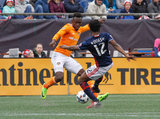Alberth Elis (17) and Xavier Kouassi (12) during New England Revolution and Houston Dynamo MLS match at Gillette Stadium in Foxboro, MA on Saturday, April 8, 2017.  Revs won 2-0 CREDIT/ CHRIS ADUAMA