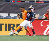 Lee Nguyen (24) and Mauro Manotas (19) during New England Revolution and Houston Dynamo MLS match at Gillette Stadium in Foxboro, MA on Saturday, April 8, 2017.  Revs won 2-0 CREDIT/ CHRIS ADUAMA