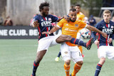 Xavier Kouassi (12) and Alex (14) during New England Revolution and Houston Dynamo MLS match at Gillette Stadium in Foxboro, MA on Saturday, April 8, 2017.  Revs won 2-0 CREDIT/ CHRIS ADUAMA
