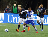 Diego Fagundez (14) and Santiago Mosquera (11) during New England Revolution and FC Dallas MLS match at Gillette Stadium in Foxboro, MA on Saturday, April 14, 2018. Revs lost 0-1. CREDIT/ CHRIS ADUAMA