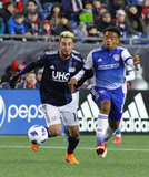 Diego Fagundez (14) Jacori Hayes (15) during New England Revolution and FC Dallas MLS match at Gillette Stadium in Foxboro, MA on Saturday, April 14, 2018. Revs lost 0-1. CREDIT/ CHRIS ADUAMA