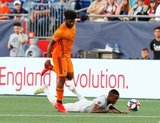 Michael Salazar (19), Luis Caicedo (27) during New England Revolution and Houston Dynamo MLS match at Gillette Stadium in Foxboro, MA on Saturday, June 29, 2019.  Revs won 2-1. CREDIT/CHRIS ADUAMA