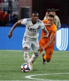 Luis Caicedo (27), Darwin Ceren (24) during New England Revolution and Houston Dynamo MLS match at Gillette Stadium in Foxboro, MA on Saturday, June 29, 2019.  Revs won 2-1. CREDIT/CHRIS ADUAMA