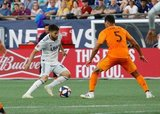 Carles Gil (22), Juan Cabezas (5) during New England Revolution and Houston Dynamo MLS match at Gillette Stadium in Foxboro, MA on Saturday, June 29, 2019.  Revs won 2-1. CREDIT/CHRIS ADUAMA