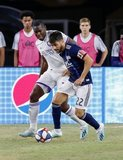 Kamal Miller (27), Carles Gil (22) during New England Revolution and Orlando City SC MLS match at Gillette Stadium in Foxboro, MA on Saturday, July 27, 2019.  Revs won 4-1. CREDIT/CHRIS ADUAMA