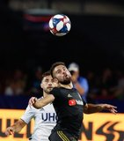 Carles Gil (22), Diego Rossi (9) during New England Revolution and Los Angeles Football Club MLS match at Gillette Stadium in Foxboro, MA on Saturday, August 3, 2019. LAFC won 2-0. CREDIT/CHRIS ADUAMA