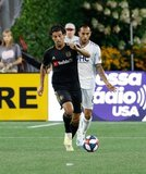 Edgar Castillo (8), Carlos Vela (10) during New England Revolution and Los Angeles Football Club MLS match at Gillette Stadium in Foxboro, MA on Saturday, August 3, 2019. LAFC won 2-0. CREDIT/CHRIS ADUAMA
