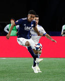 Juan Agudelo (17), Daniel Lovitz (3) during New England Revolution and Montreal Impact MLS match at Gillette Stadium in Foxboro, MA on Wednesday, April 24, 2019. Montreal beat Revs 3-0. CREDIT/ CHRIS ADUAMA