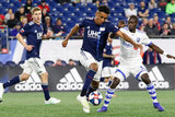 Juan Agudelo (17), Michael Azira (32) during New England Revolution and Montreal Impact MLS match at Gillette Stadium in Foxboro, MA on Wednesday, April 24, 2019. Montreal beat Revs 3-0. CREDIT/ CHRIS ADUAMA