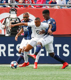 Angelo Rodriguez (9), Jalil Anibaba (3) during New England Revolution and Minnesota United FC MLS match at Gillette Stadium in Foxboro, MA on Saturday, March 30, 2019. Revs won 2-1. CREDIT/ CHRIS ADUAMA