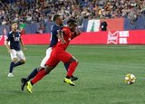 Cristian Penilla (70), Richie Laryea (22) during New England Revolution and Toronto FC MLS match at Gillette Stadium in Foxboro, MA on Saturday, August 31, 2019. The match ended in 1-1 tie. CREDIT/ CHRIS ADUAMA
